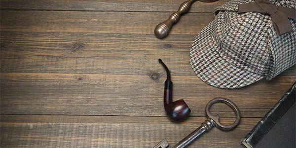 Investigator style pipe, keys, and hat - different attire from eDiscovery investigators.